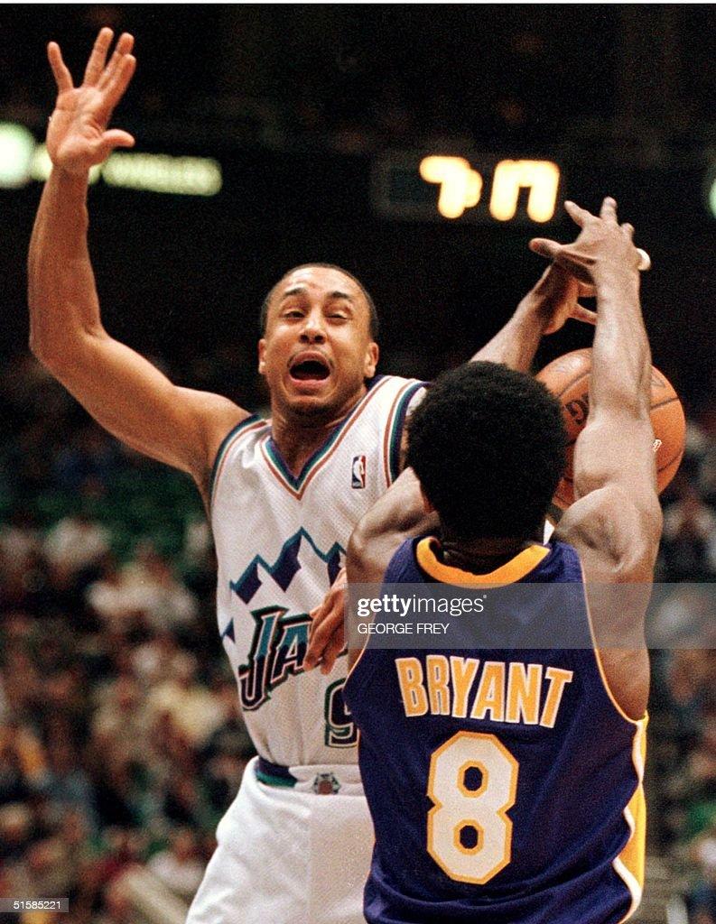 John Starks L of the Utah Jazz is fouled by Kobe