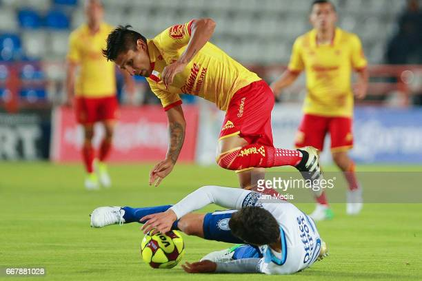 John Stefan Medina of Pachuca and Raul Ruidiaz of Morelia fight for the ball during the 10th round match between Pachuca and Morelia as part of the...