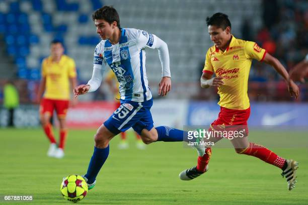 John Stefan Medina of Pachuca drives the ball while followed by Raul Ruidiaz of Morelia during the 10th round match between Pachuca and Morelia as...