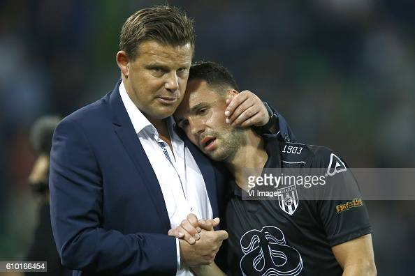 John Stegeman coach of Heracles Almelo Thomas Bruns of Heracles Almelo during the Dutch Eredivisie match between FC Groningen and Heracles Almelo at...