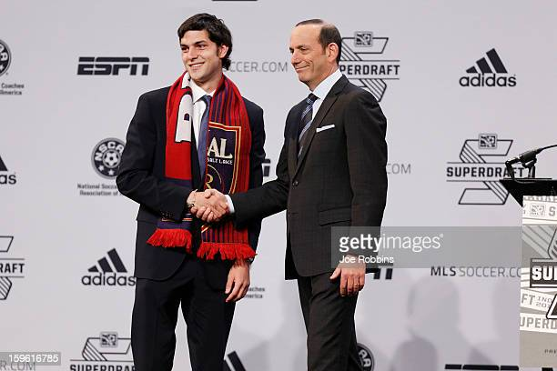 John Stertzer of Maryland shakes hands with commissioner Don Garber after being selected by Real Salt Lake as the 12th overall pick in the 2013 MLS...