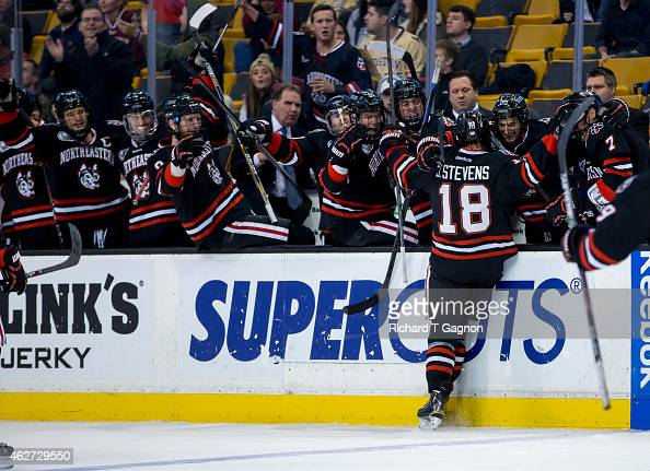 John Stevens of the Northeastern Huskies celebrates his goal against the Boston College Eagles with his teammates during NCAA hockey in the...