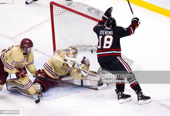 John Stevens of the Northeastern University Huskies scores a goal in the second period to tie the game 11 against Thatcher Demko of the Boston...