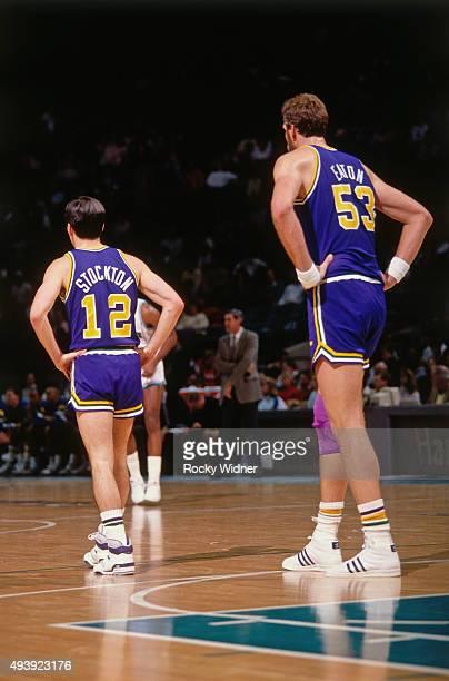 John Stockton and Mark Eaton of the Utah Jazz stand against the Charlotte Hornets on December 22 1989 at the Charlotte Coliseum in Charlotte North...