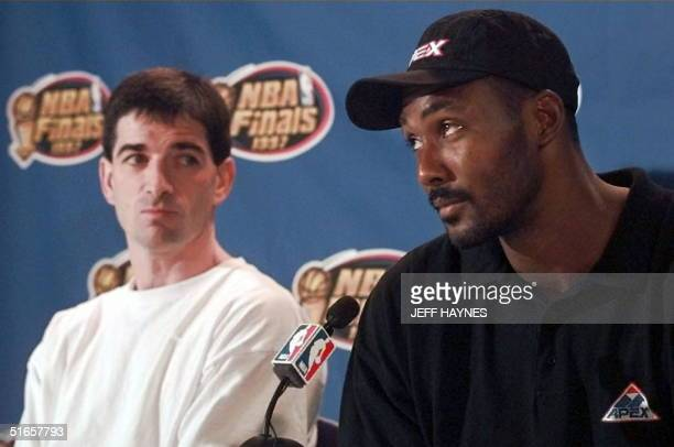 John Stockton listens to Karl Malone of the Utah Jazz answer questions 10 June at a press conference after morning workouts in preparation for game...