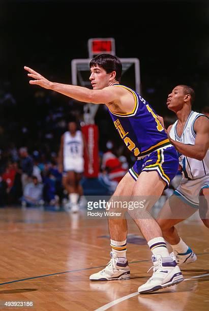 John Stockton of the Utah Jazz calls for the ball against the Charlotte Hornets on December 22 1989 at the Charlotte Coliseum in Charlotte North...