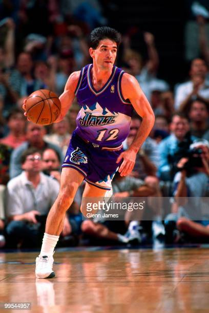 John Stockton of the Utah Jazz drives the ball up court against the Houston Rockets in Game Four of the Western Conference Finals during the 1997 NBA...