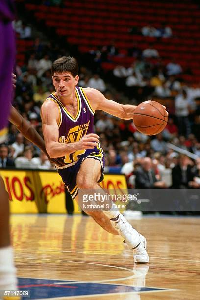 John Stockton of the Utah Jazz drives to the basket against the New Jersey Nets during an NBA game in 1991 at the Brendan Byrne Arena in East...
