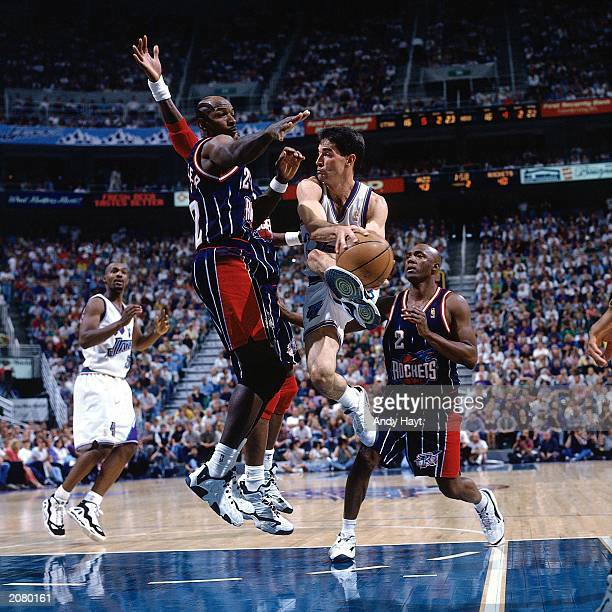 John Stockton of the Utah Jazz goes in for a layup during a 1997 NBA game against the Houston Rockets at the Delta Center in Salt Lake City Utah NOTE...