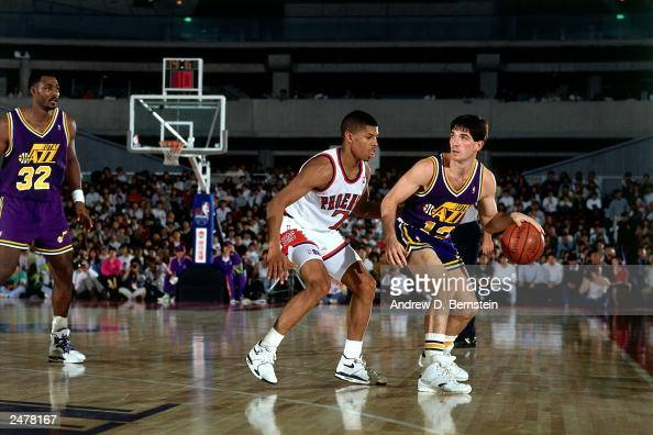 John Stockton of the Utah Jazz looks to drive against Kevin Johnson of the Phoenix Suns during the 1990 Japan Games at the Tokyo Dome in Tokyo Japan...