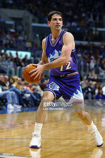 John Stockton of the Utah Jazz looks to pass during the game against the Los Angeles Clippers at Staples Center on April 1 2003 in Los Angeles...