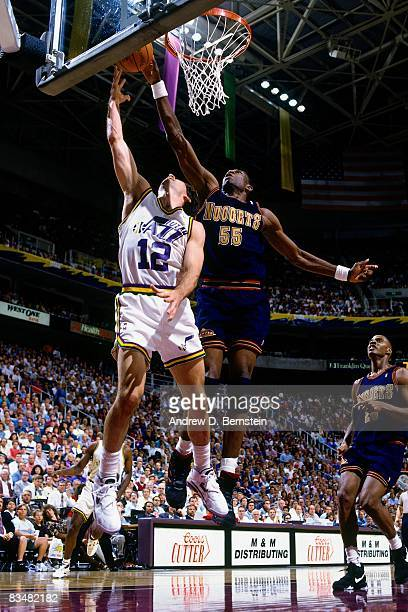 John Stockton of the Utah Jazz shoots a layup against Dikembe Mutombo of the Denver Nuggets during Game Five of the 1994 Western Conference...