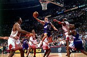John Stockton of the Utah Jazz shoots a layup against Scottie Pippen of the Chicago Bulls in Game Four of the 1998 NBA Finals at the United Center on...