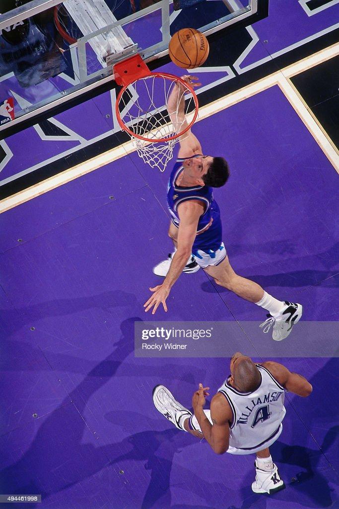 John Stockton of the Utah Jazz shoots against the Sacramento Kings circa 1997 at Arco Arena in Sacramento California NOTE TO USER User expressly...