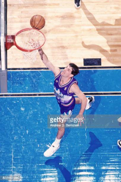 John Stockton of the Utah Jazz shoots during the 1997 AllStar Game on February 9 1997 at Gund Arena in Cleveland Ohio NOTE TO USER User expressly...