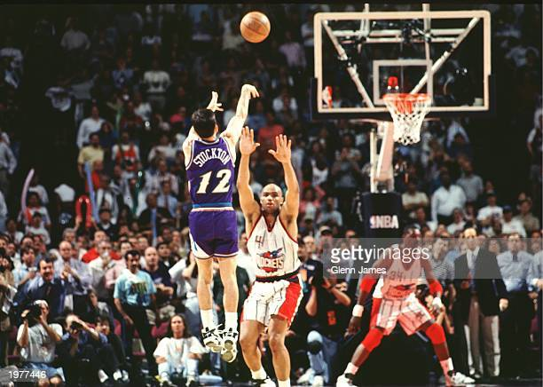 John Stockton of the Utah Jazz shoots the game winning shot over Charles Barkley of the Houston Rockets in Game six of the Western Conference...