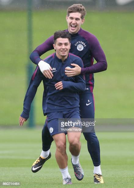 John Stones and Brahim Diaz joke at training at Manchester City Football Academy on October 11 2017 in Manchester England