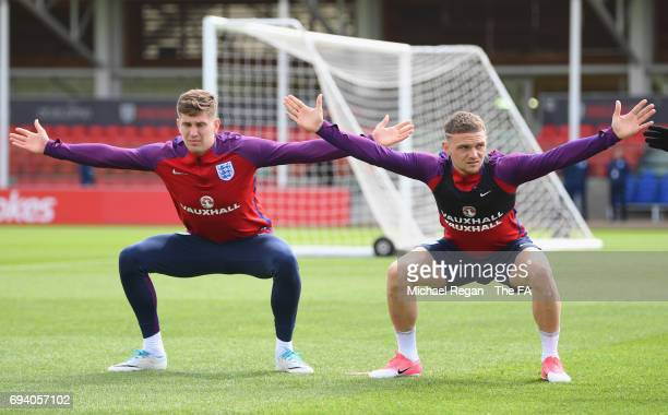 John Stones and Kieran Trippier of England stretch during an England training session on the eve of their FIFA World Cup qualifier against Scotland...