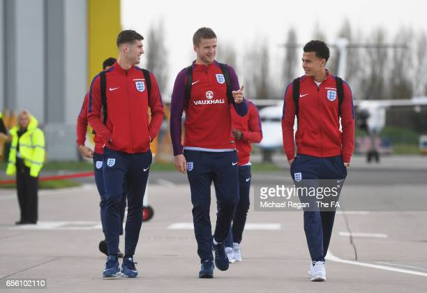 John Stones Eric Dier and Dele Alli of England walk to the plane as they leave for the International Friendly match against Germany at Birmingham...