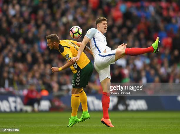 John Stones of England and Nerijus Valskis of Lithuania in action during the FIFA 2018 World Cup Qualifier between England and Lithuania at Wembley...