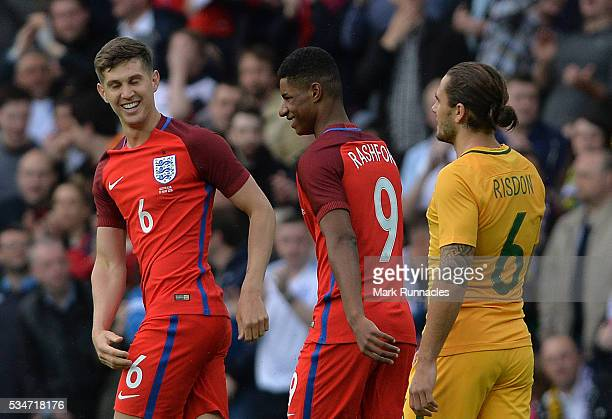 John Stones of England celebrate with goal scorer Marcus Rashford of England after he scored in the first half during the International Friendly...