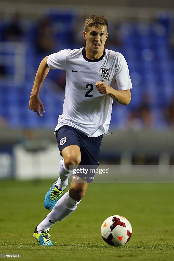 <a gi-track='captionPersonalityLinkClicked' href=/galleries/search?phrase=John+Stones&family=editorial&specificpeople=9603494 ng-click='$event.stopPropagation()'>John Stones</a> of England in action during the 2015 UEFA European U21 Championships Qualifier between England U21 and Moldova U21 at the Madejski Stadium on September 5, 2013 in Reading, England.