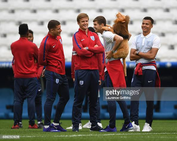 John Stones of England is the centre of attention with Ross Barkley Eric Dier and Dele Alli during an England training session ahead of the EURO 2016...