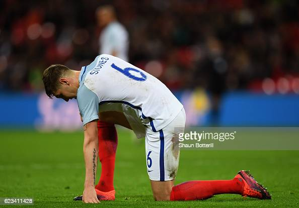 John Stones of England reacts as Iago Aspas of Spain scores their first goal during the international friendly match between England and Spain at...