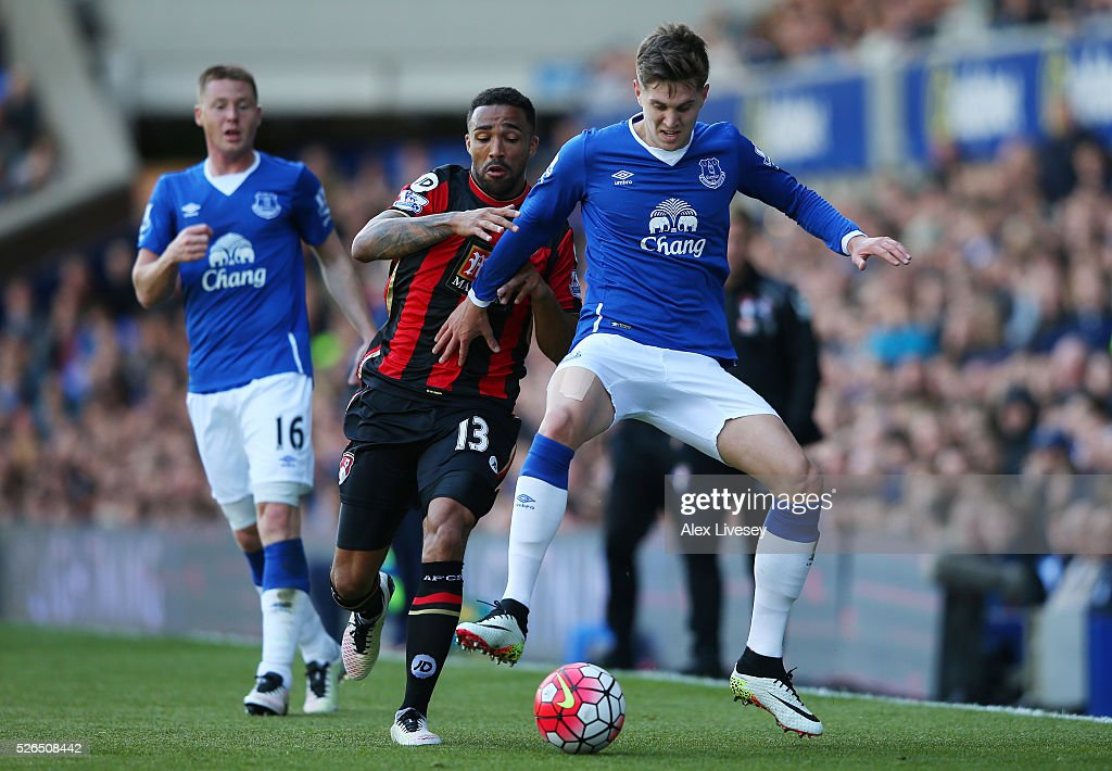 John Stones of Everton and Callum Wilson of Bournemouth compete for the ball during the Barclays Premier League match between Everton and A.F.C. Bournemouth at Goodison Park on April 30, 2016 in Liverpool, England.