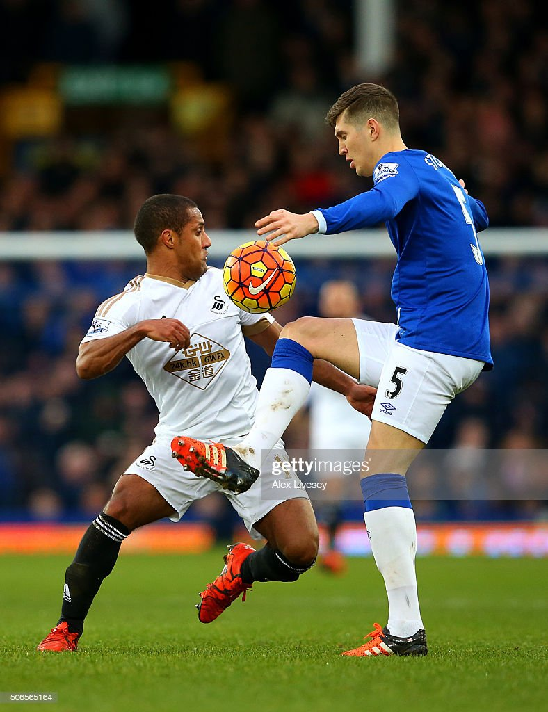 John Stones of Everton battles for the ball with Wayne Routledge of Swansea City during the Barclays Premier League match between Everton and Swansea City at Goodison Park on January 24, 2016 in Liverpool, England.