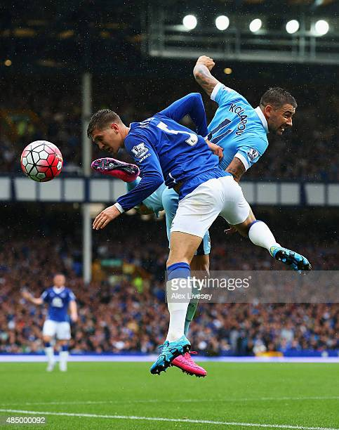 John Stones of Everton challenges for the ball with Aleksandar Kolarov of Manchester City during the Barclays Premier League match between Everton...