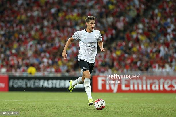 John Stones of Everton dribbles the ball during the Barclays Asia Trophy match between Arsenal and Everton at the National Stadium on July 18 2015 in...