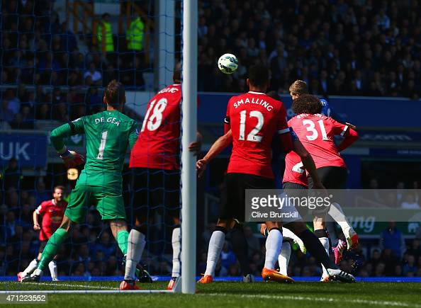 John Stones of Everton scores their second goal with a header during the Barclays Premier League match between Everton and Manchester United at...