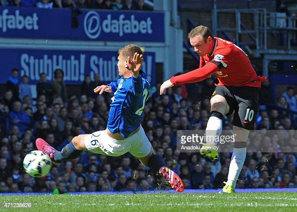 John Stones of Everton vies for ball with Wayne Rooney of Manchester United during the Barclays Premier League match between Everton and Manchester...