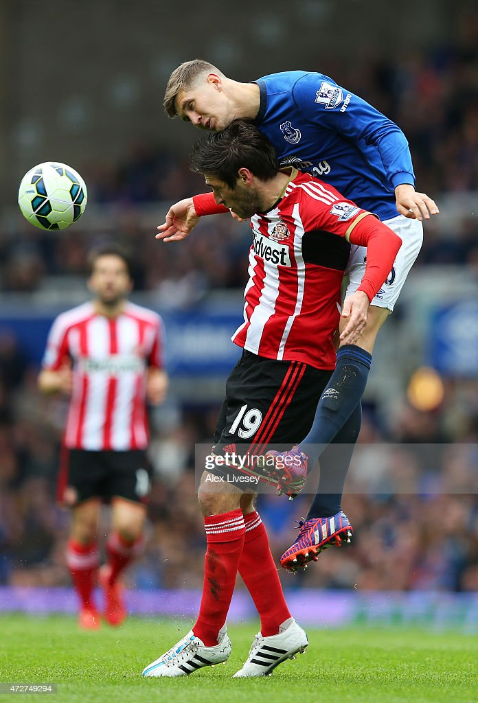 John Stones of Everton wins a header with Danny Graham of Sunderland during the Barclays Premier League match between Everton and Sunderland at...