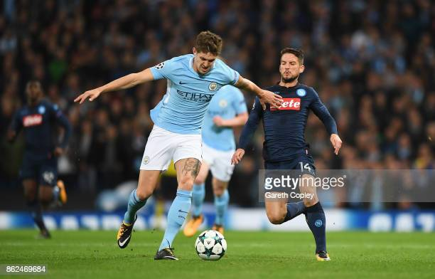 John Stones of Manchester City and Dries Mertens of SSC Napoli battle for possession during the UEFA Champions League group F match between...