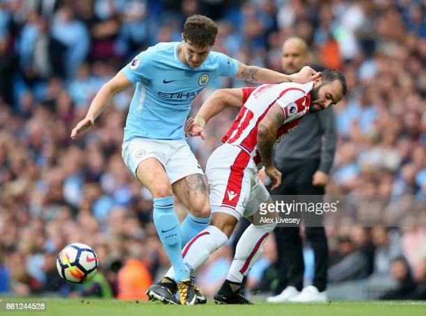 John Stones of Manchester City and Jese of Stoke City battle for possession during the Premier League match between Manchester City and Stoke City at...