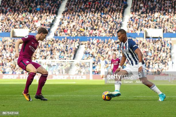 John Stones of Manchester City and Jose Solomon Rondon of West Bromwich Albion during the Premier League match between West Bromwich Albion and...