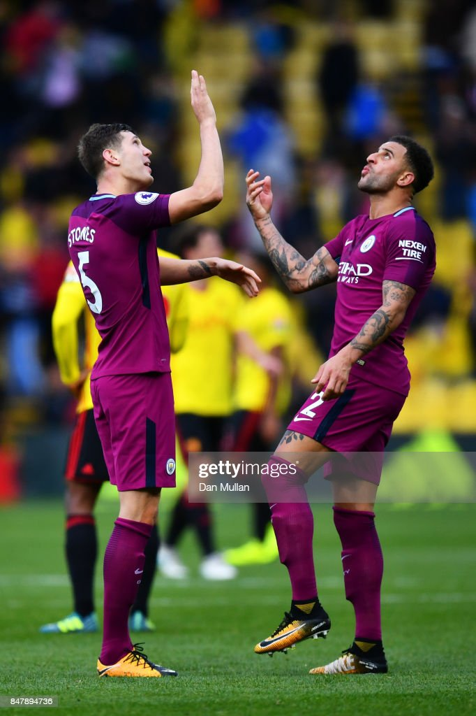 John Stones of Manchester City and Kyle Walker of Manchester City celebrate victory after the Premier League match between Watford and Manchester City at Vicarage Road on September 16, 2017 in Watford, England.
