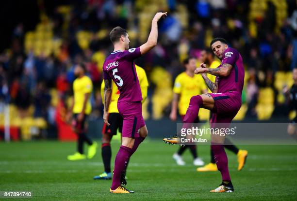 John Stones of Manchester City and Kyle Walker of Manchester City celebrate victory after the Premier League match between Watford and Manchester...