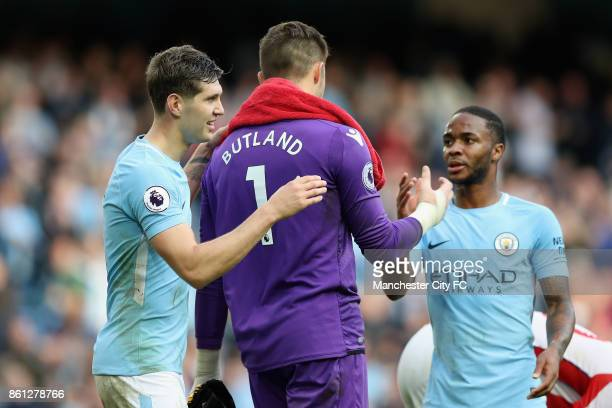 John Stones of Manchester City and Raheem Sterling of Manchester City shake hands with Jack Butland of Stoke City during the Premier League match...