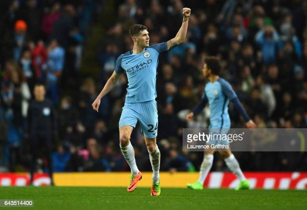 John Stones of Manchester City celebrates as he scores their fourth goal during the UEFA Champions League Round of 16 first leg match between...