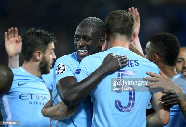 John Stones of Manchester City celebrates his second goal with Benjamin Mendy during the UEFA Champions League match between Feyenoord Rotterdam and...