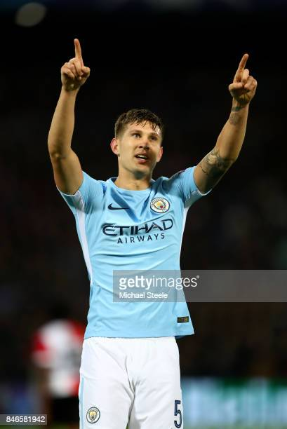 John Stones of Manchester City celebrates scoring his sides fourth goal during the UEFA Champions League group F match between Feyenoord and...