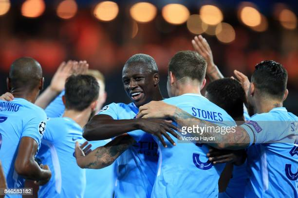 John Stones of Manchester City celebrates scoring his sides fourth goal with his Manchester City team mates during the UEFA Champions League group F...