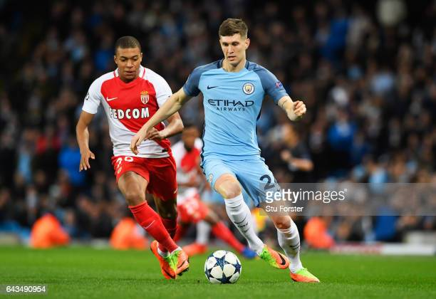 John Stones of Manchester City is chased by Kylian Mbappe of AS Monaco during the UEFA Champions League Round of 16 first leg match between...