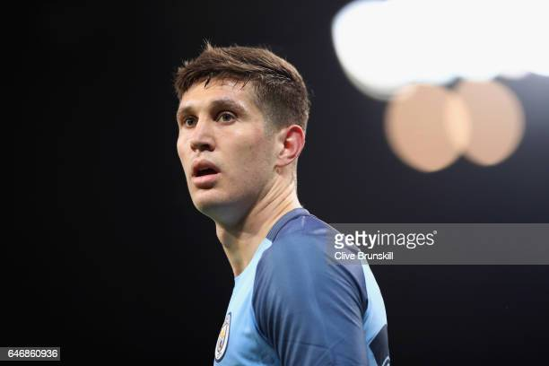John Stones of Manchester City looks on during The Emirates FA Cup Fifth Round Replay match between Manchester City and Huddersfield Town at Etihad...