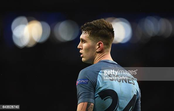 John Stones of Manchester City looks on during the UEFA Champions League Round of 16 first leg match between Manchester City FC and AS Monaco at...