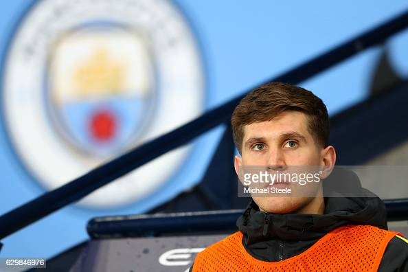 John Stones of Manchester City looks on from the bench during the Premier League match between Manchester City and Watford at Etihad Stadium on...