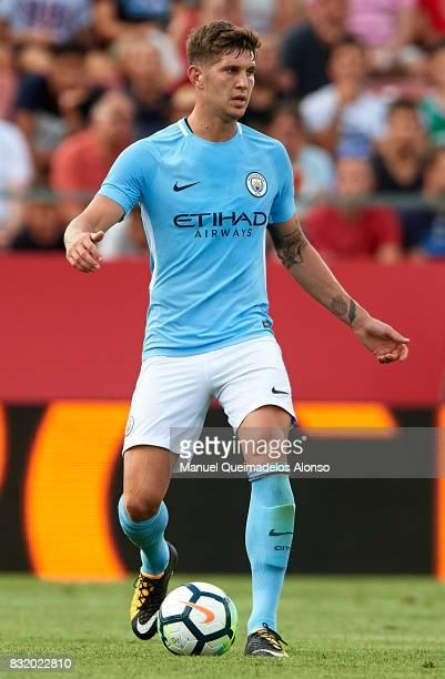 John Stones of Manchester City runs with the ball during the preseason friendly match between Girona and Manchester City at Municipal de Montilivi...